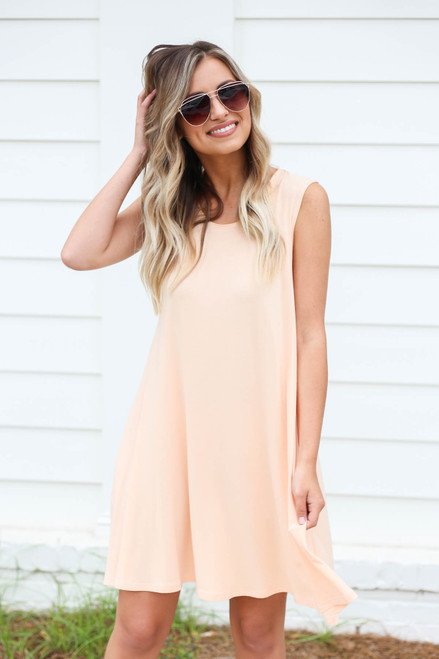 Model wearing Peach Pocketed Swing Dress