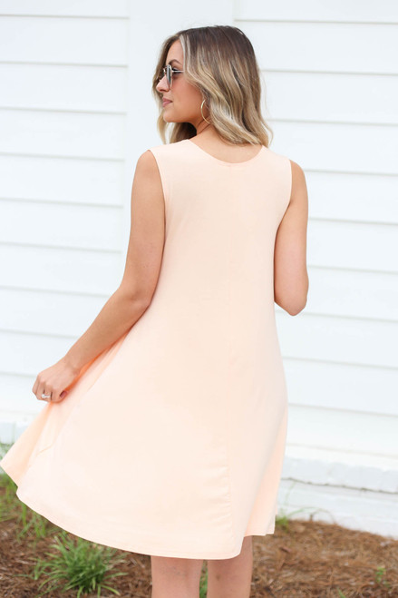 Model wearing Peach Pocketed Swing Dress Back View