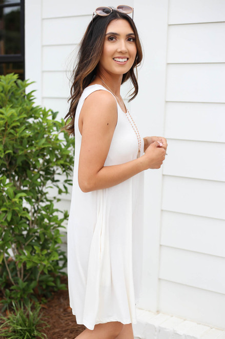 Model wearing White Pocketed Swing Dress Side View