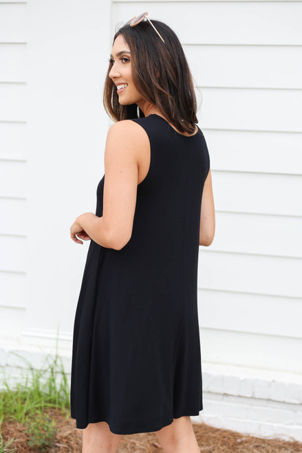 Model wearing Black Pocketed Swing Dress Back View