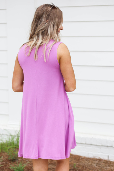 Model wearing Purple Pocketed Swing Dress Back View