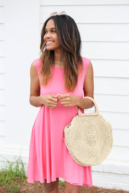 Model wearing Neon Pink Pocketed Swing Dress Front View