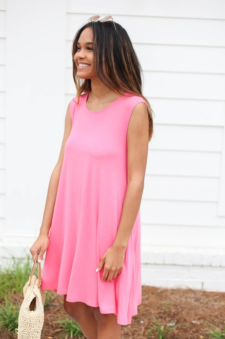 Model wearing Neon Pink Pocketed Swing Dress Side View
