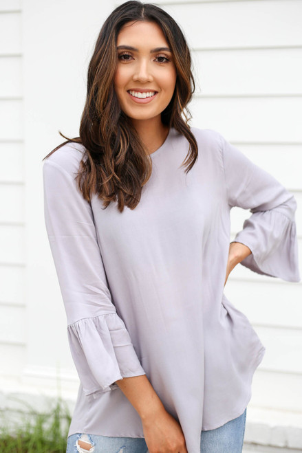 Model wearing Grey Ruffle Sleeve Blouse Front View
