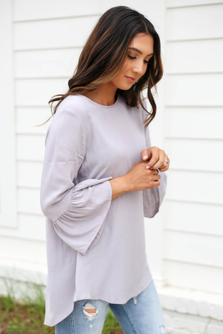 Model wearing Grey Ruffle Sleeve Blouse Side View