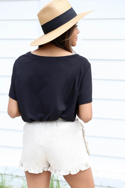Model wearing Taupe Ruffled Linen Shorts Back View