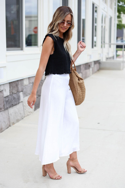 Model wearing White Button Front Cropped Pants Side View