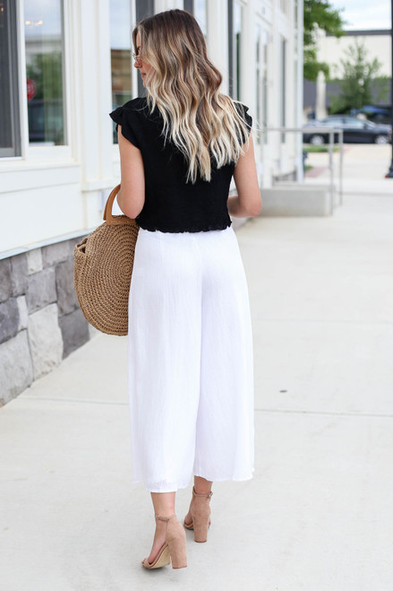 Model wearing White Button Front Cropped Pants Back View