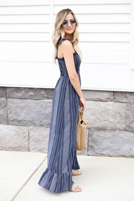 Model wearing Navy  Smocked Striped Maxi Dress Side View