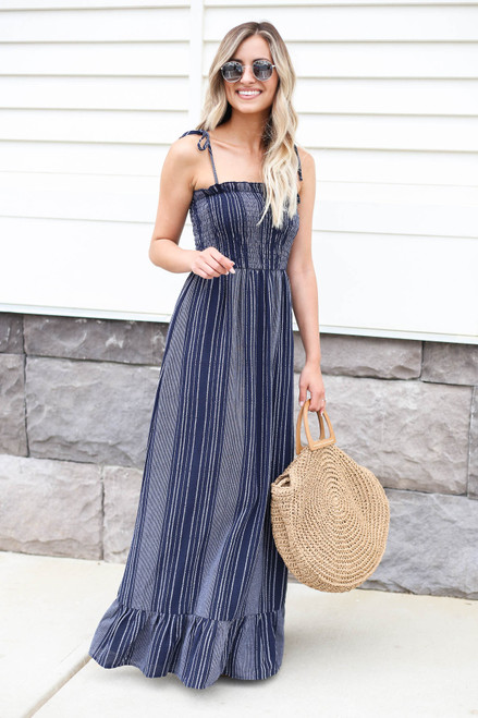 Model wearing Navy  Smocked Striped Maxi Dress Front View