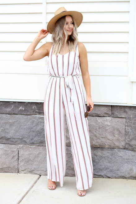 Model wearing White Jumpsuit with Red and Black Stripes