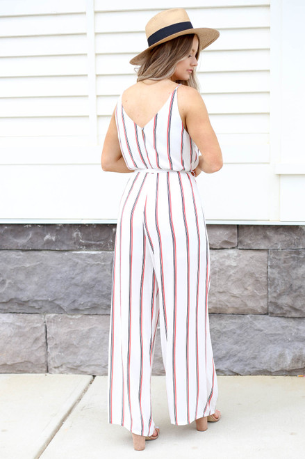 Model wearing White Jumpsuit with Red and Black Stripes Back View