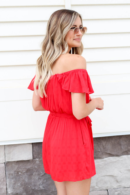 Model wearing Red Off the Shoulder Flutter Sleeve Romper Back View