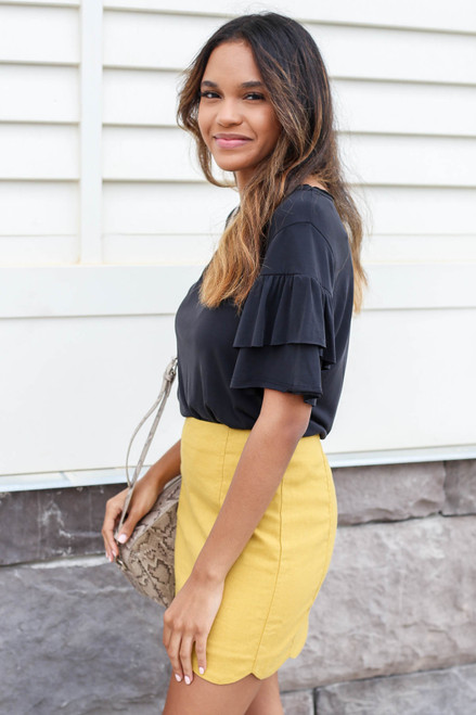 Model wearing Mustard Scalloped Mini Skirt Side View