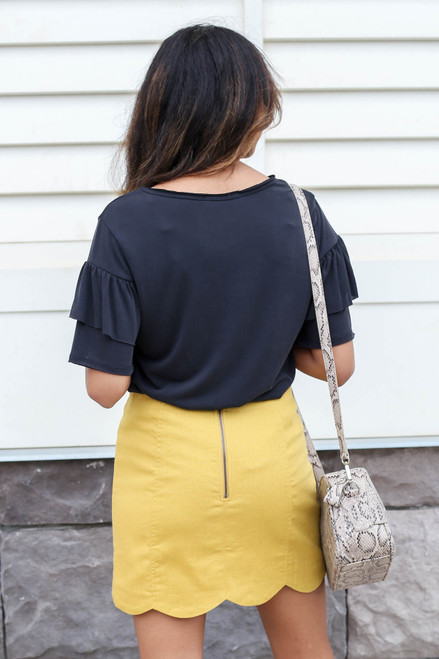 Model wearing Mustard Scalloped Mini Skirt Back View
