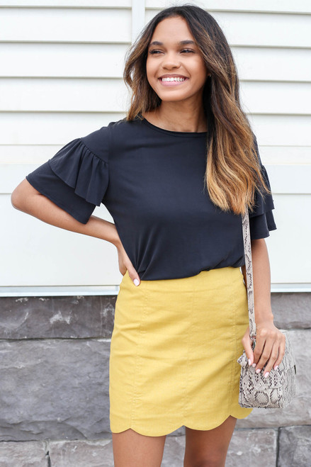 Model wearing Mustard Scalloped Mini Skirt Front View