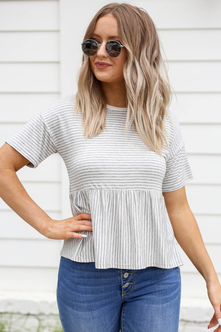 Model wearing White Striped Peplum Tee Front View