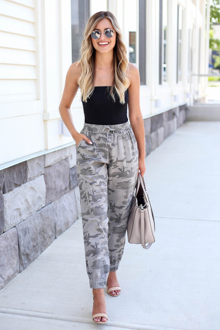 Model wearing Camo Cargo Jogger Pants Front View