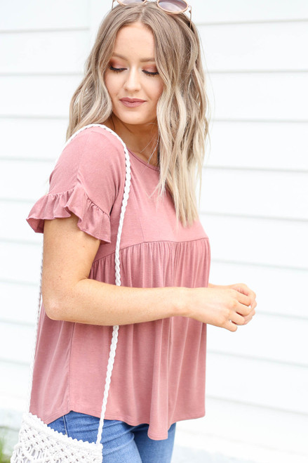 Model wearing Mauve Ruffled Sleeve Babydoll Top Side View