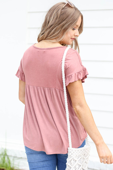 Model wearing Mauve Ruffled Sleeve Babydoll Top Back View