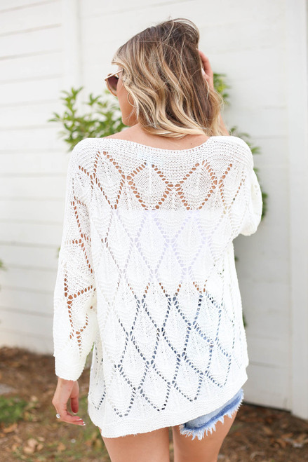 Model wearing White Eyelet Open Knit Sweater Back View