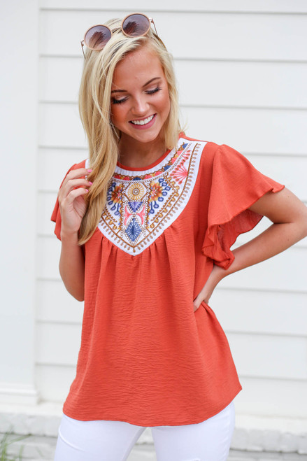 Model wearing Rust Embroidered Ruffle Sleeve Top