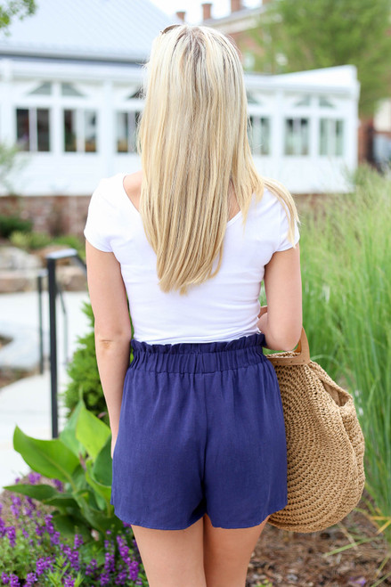Model wearing Navy Paperbag Waist Shorts Back View