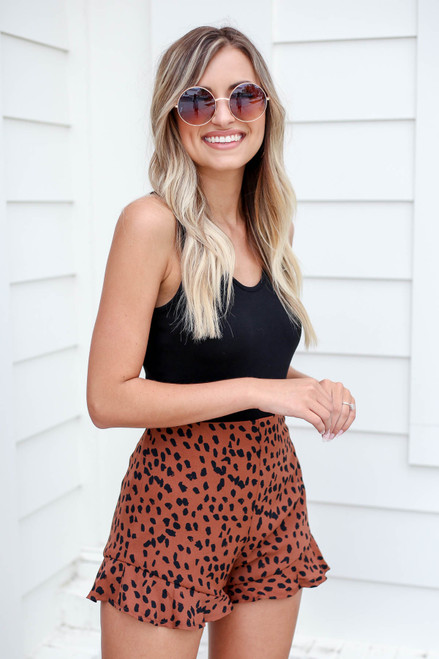 Model wearing Brown Spotted Ruffle Shorts Front View