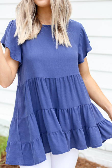 Model wearing Navy Tiered Ruffle Sleeve Blouse Detail View