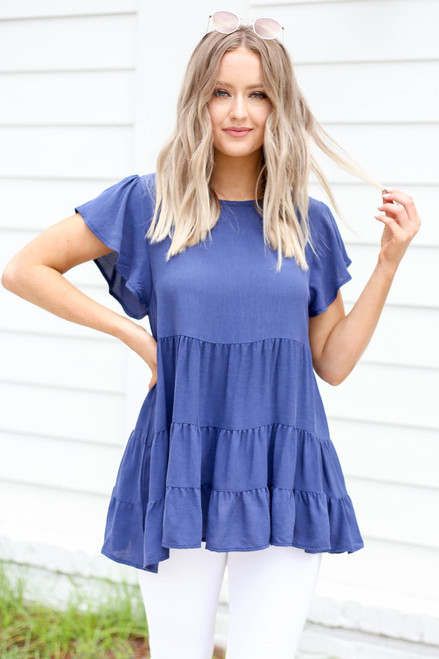 Model wearing Navy Tiered Ruffle Sleeve Blouse Full View