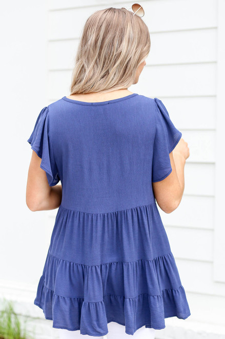 Model wearing Navy Tiered Ruffle Sleeve Blouse Back View