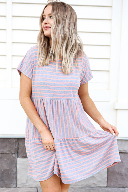 Model wearing Grey and Pink Striped Tiered Dress Front View