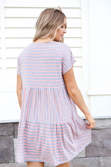 Model wearing Grey and Pink Striped Tiered Dress Back View