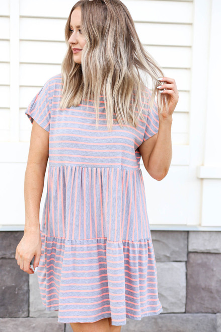 Model wearing Grey and Pink Striped Tiered Dress