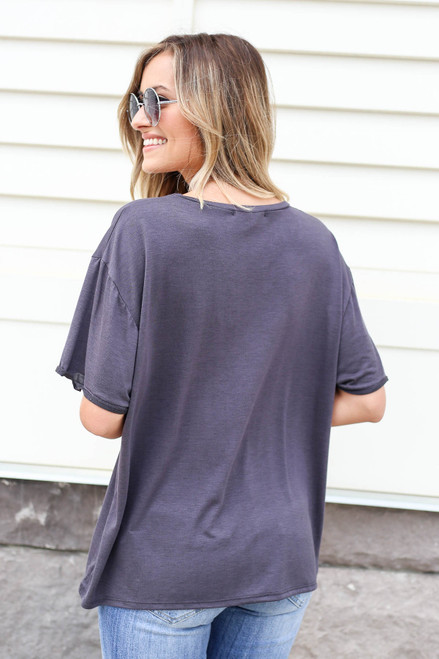 Model wearing Black Soft Knit Burnout Tee Back View
