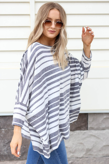 Model wearing Navy Oversized Striped Top Side View