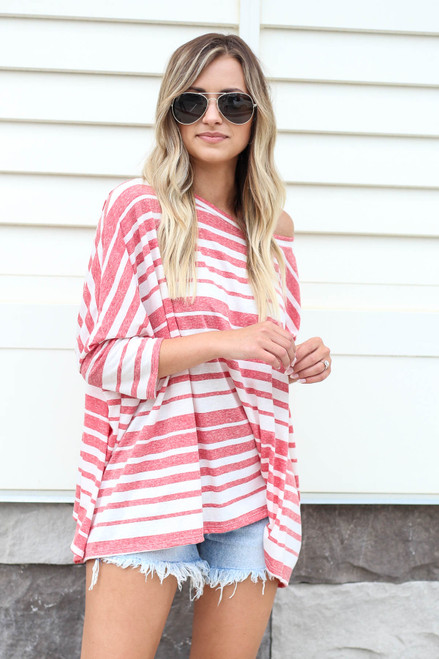 Model wearing Red Oversized Striped Top Front View