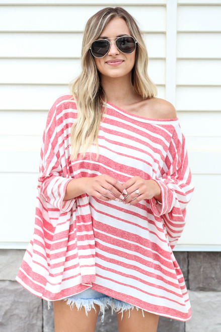 Model wearing Red Oversized Striped Top