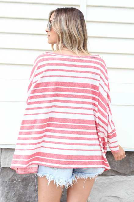 Model wearing Red Oversized Striped Top Back View