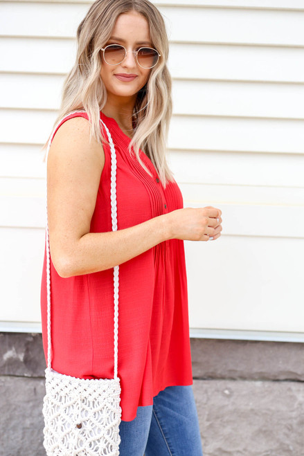 Model wearing Red Pleated Front Sleeveless Blouse Side View