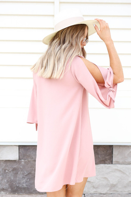 Model wearing Blush Tie Sleeve Mini Cocktail Dress Back View