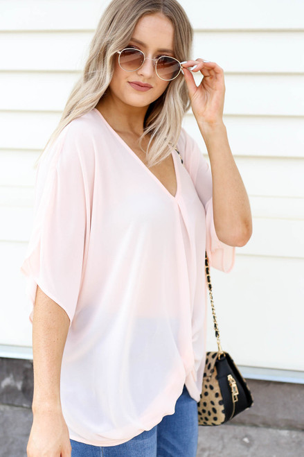 Model wearing Blush Twist Front Blouse Side View