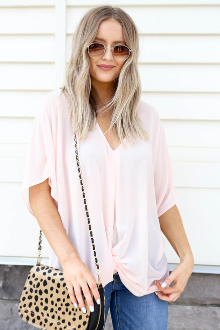 Model wearing Blush Twist Front Blouse