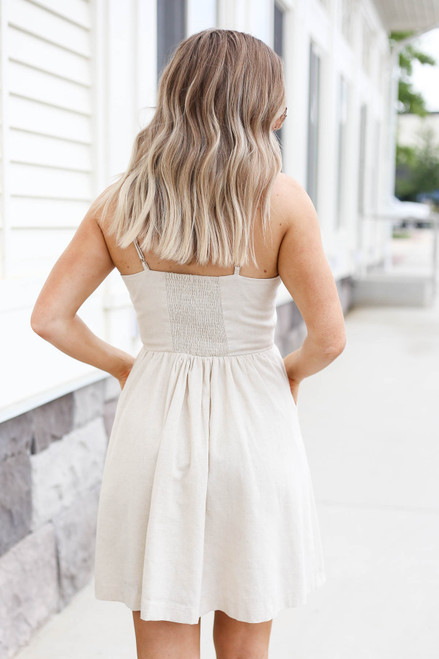 Model wearing Natural Button Front Mini Dress Back View