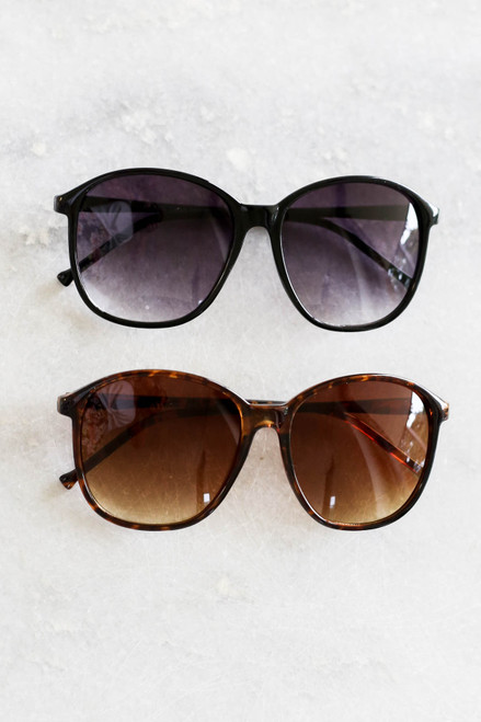 Black - and Tortoise Oversized Sunglasses Flat Lay