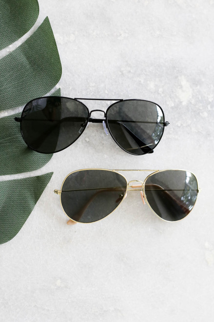 Black - And Gold Aviator Sunglasses Flat Lay