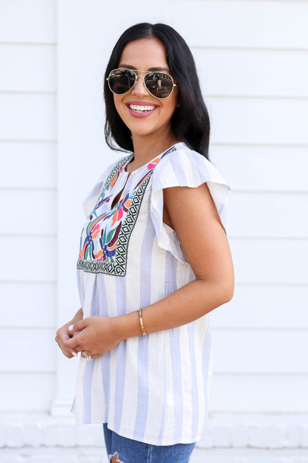 Model wearing Blue and White Striped Embroidered Blouse Side View