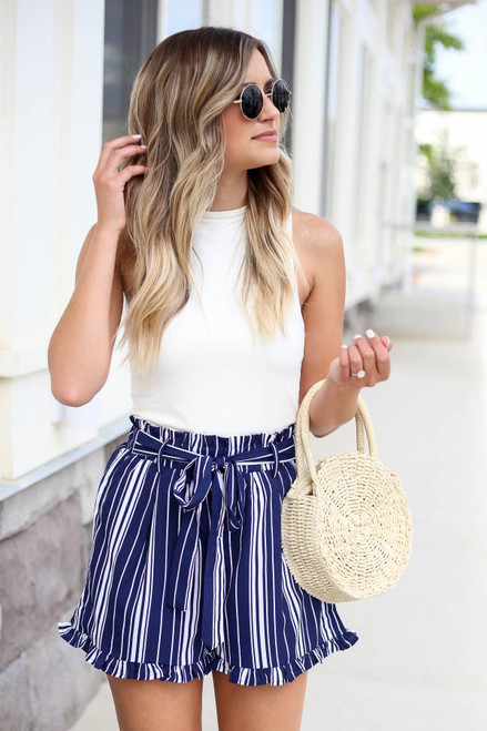 Model wearing Navy and White Striped Paperbag Waist Shorts Front View