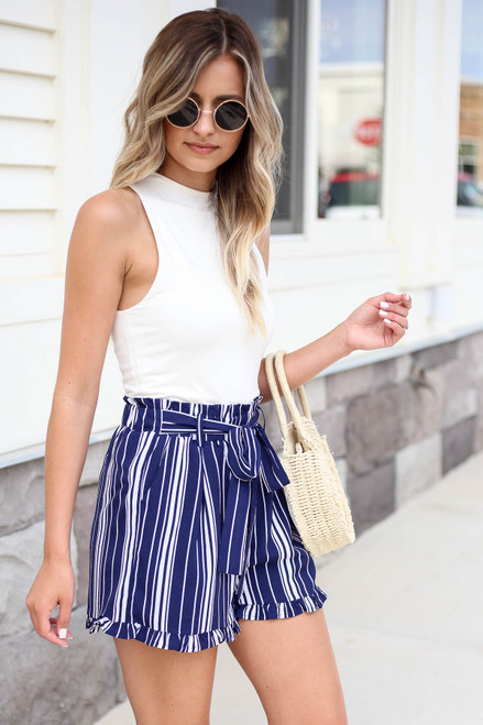 Model wearing Navy and White Striped Paperbag Waist Shorts Side View