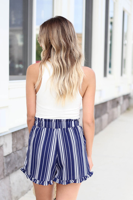 Model wearing Navy and White Striped Paperbag Waist Shorts Back View